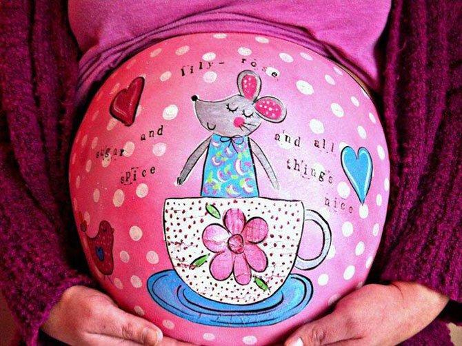 Рисунки на животах беременных девушек (9 фото)