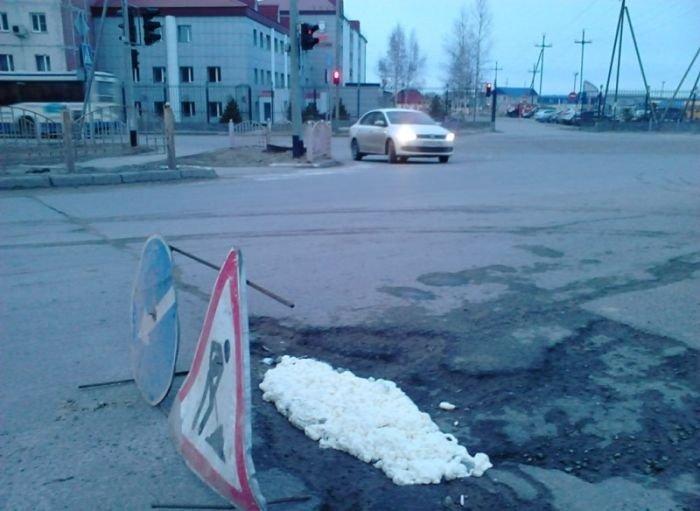 Ремонт дороги в Нефтеюганске (3 фото)